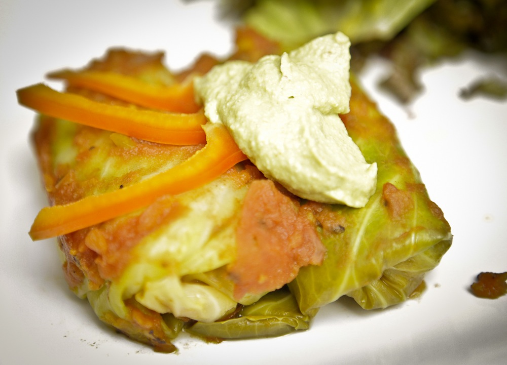 Black Bean Fiesta Stuffed Cabbage Rolls with Avocado Cashew Cream