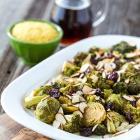 Cheesy Maple Roasted Brussels Sprouts & Broccoli with Dried Cherries & Almonds