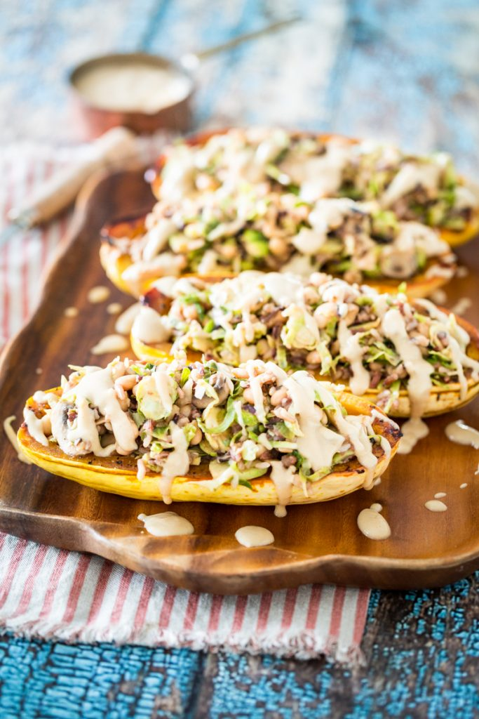 White Bean and Brussels Sprouts Stuffed Delicata Squash with Lemon Tahini Sauce